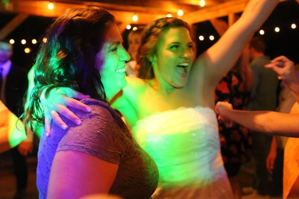 Richardson wedding - bride and guest on dance floor