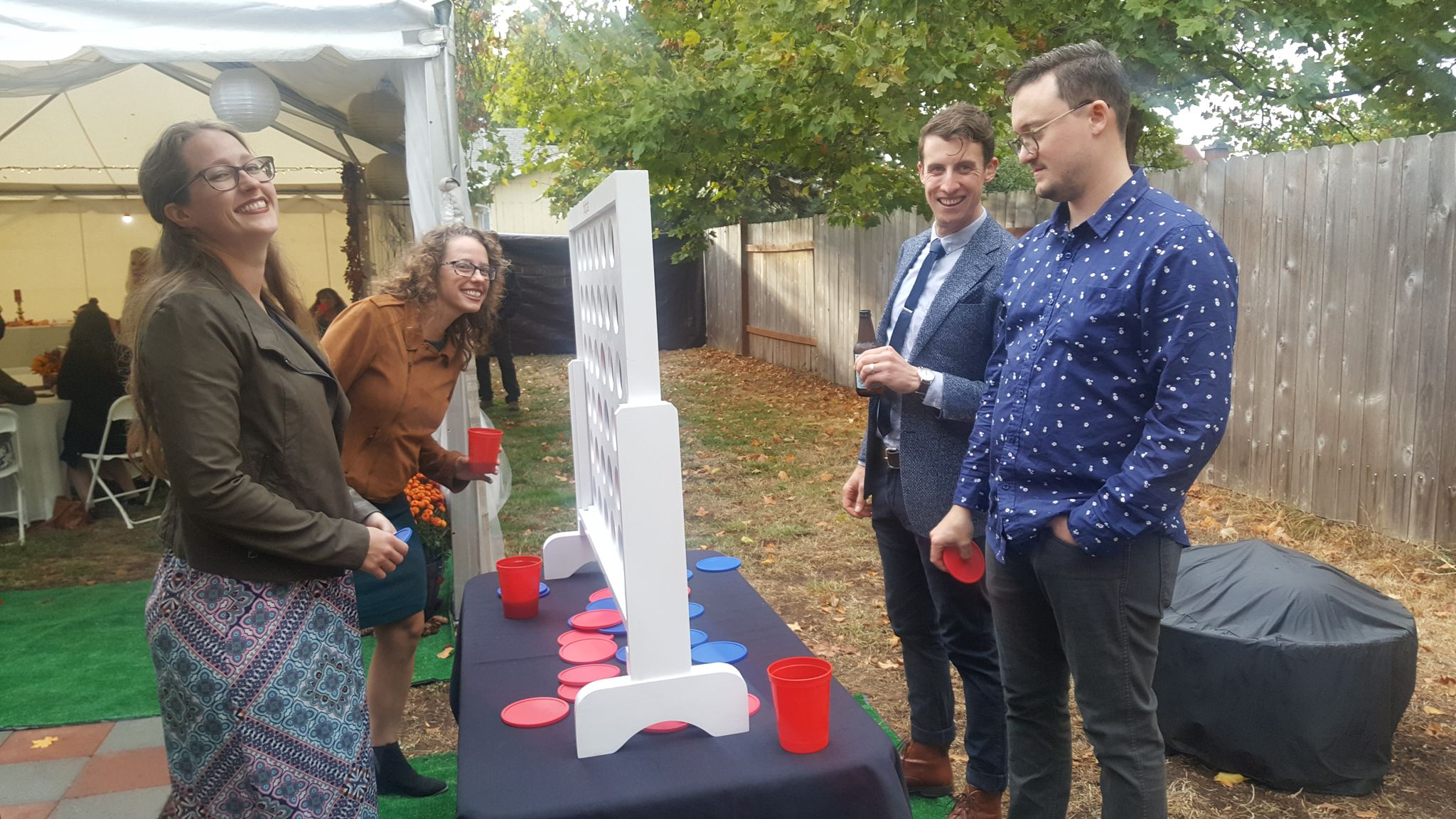 Group playing a Giant Connect Four Game